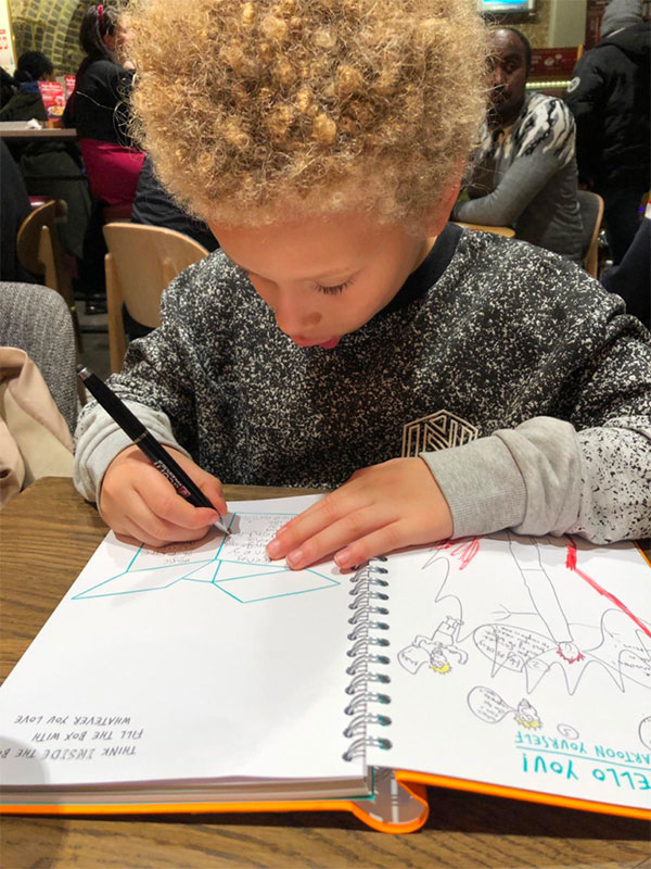 Boy drawing during a workshop